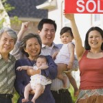 cash for houses in | asian family holding sold sign