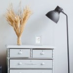 Ways to Stage Your House for a Winter Sale | lamp and dresser