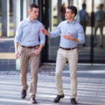 buying investment property | businessmen walking