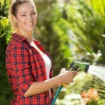 Lawn Care Mistakes That Can Ruin Your Yard | woman watering plants