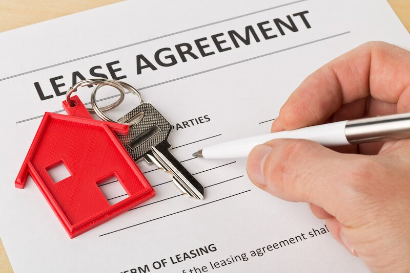 looking over lease agreement to sell house with tenants