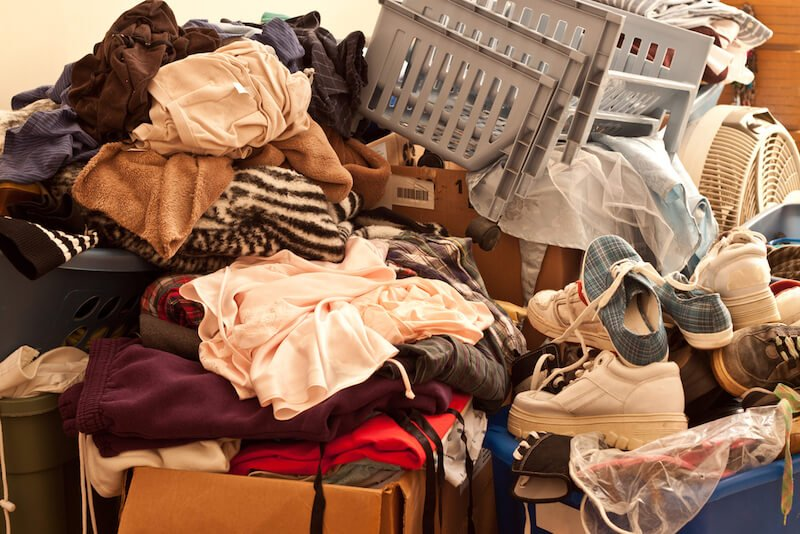 pile of clothes in a hoarder house