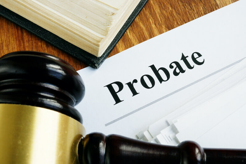 Probate sign, stack of papers and gavel