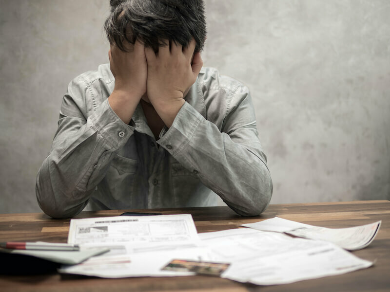 Man having financial problems, can't keep up with home finances