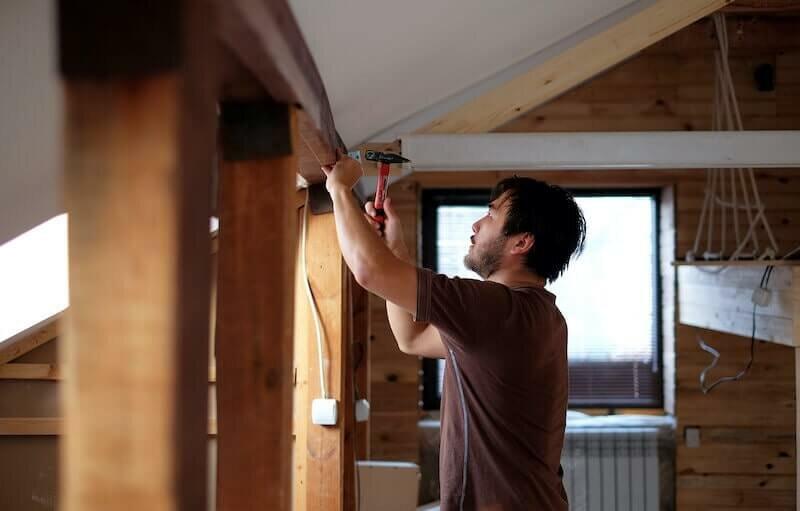 man making major electrical repair