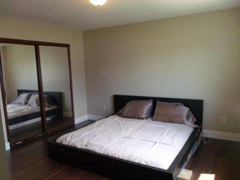 Bedroom with dark hardwood floors with seller financing Sandy UT