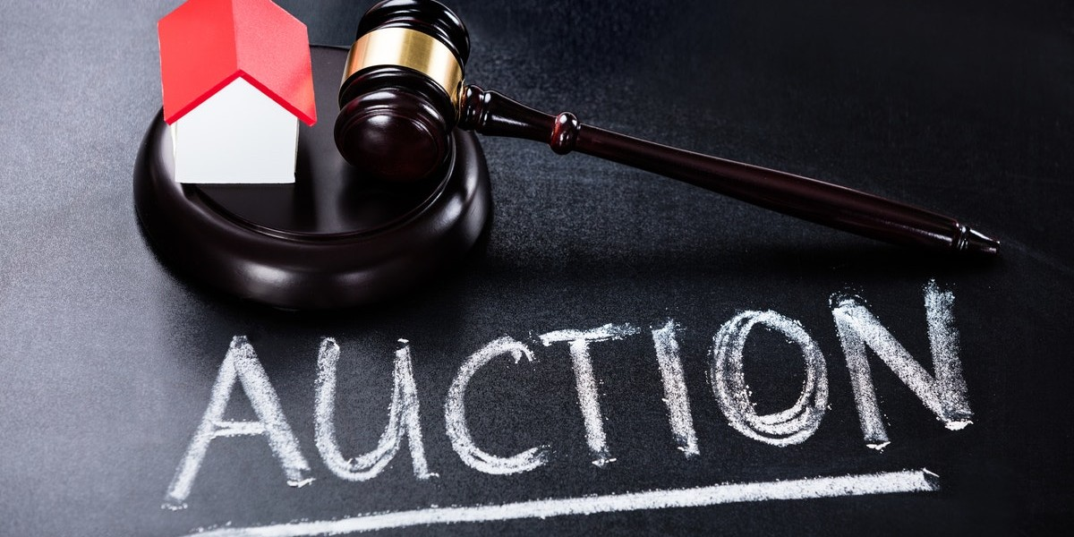 is auctioning your house a good idea | auction on chalkboard