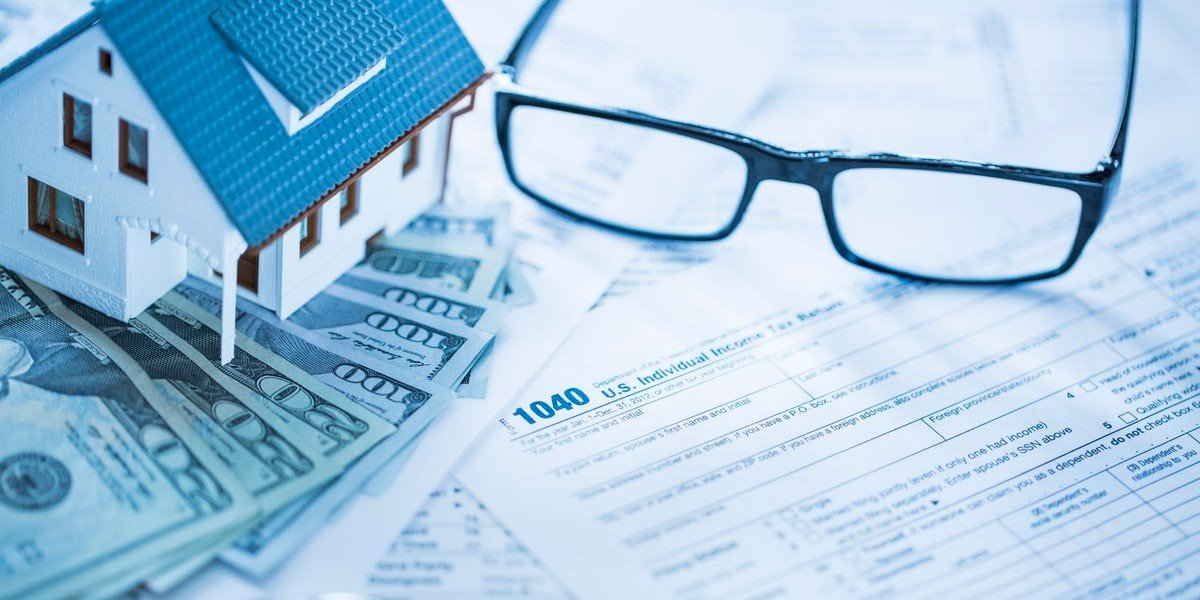 tax consequences when selling a house I inherited | model house on cash and glasses