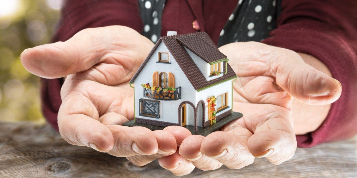 What happens when you inherit a house | hands holding model home