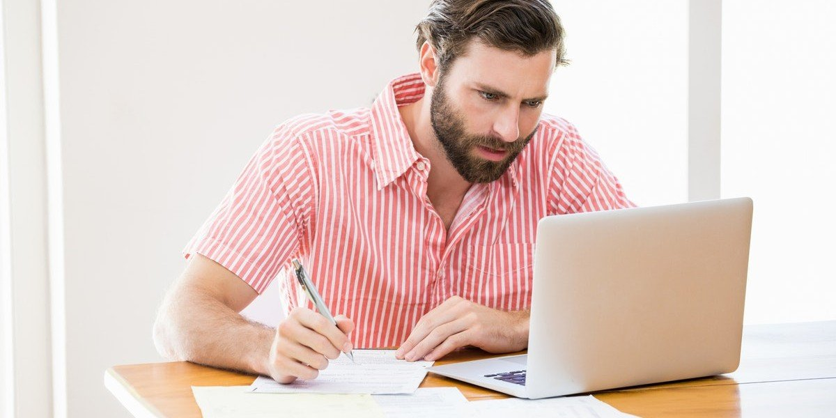 What are Closing Costs | man working on laptop