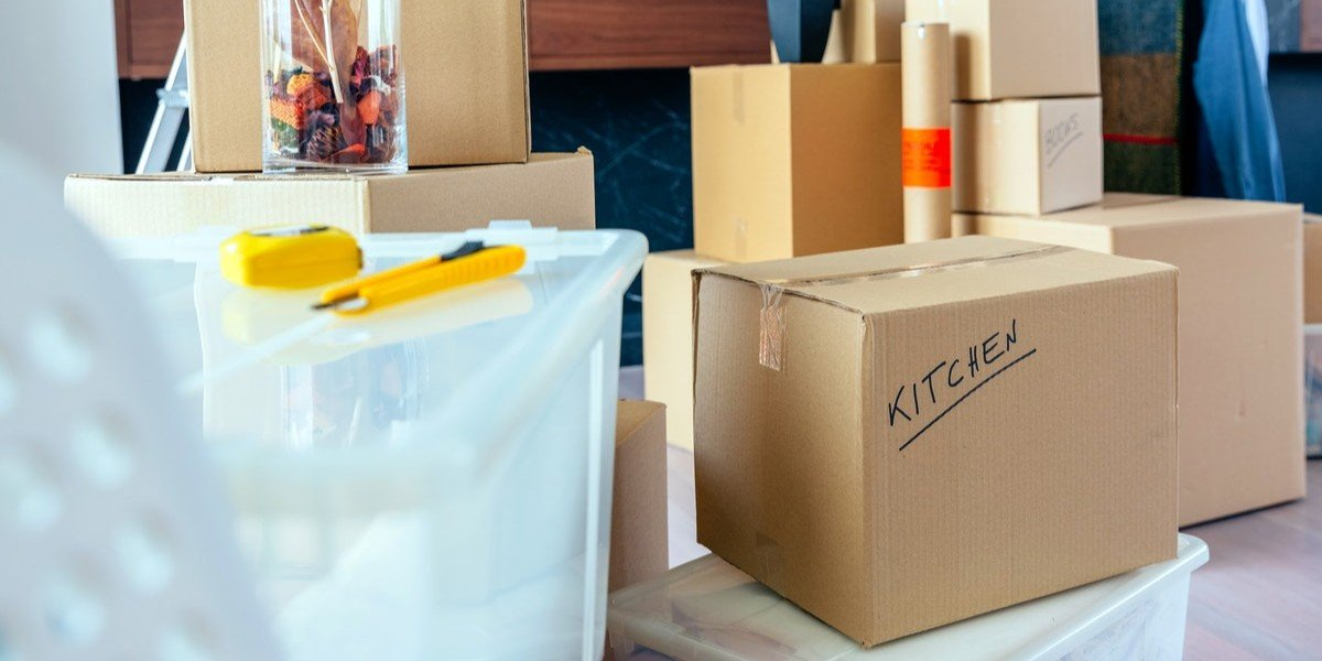 Selling Your House When You Need to Relocate | moving boxes