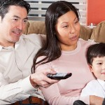Disadvantages of Buying a Home via Owner Financing | family watching tv