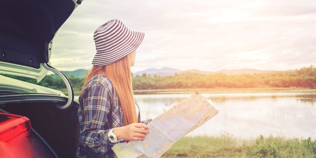 Why Selling Land Is Different Than Selling Your House   woman on lake
