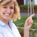 Reasons You Need To Hire A Real Estate Professional   woman pointing