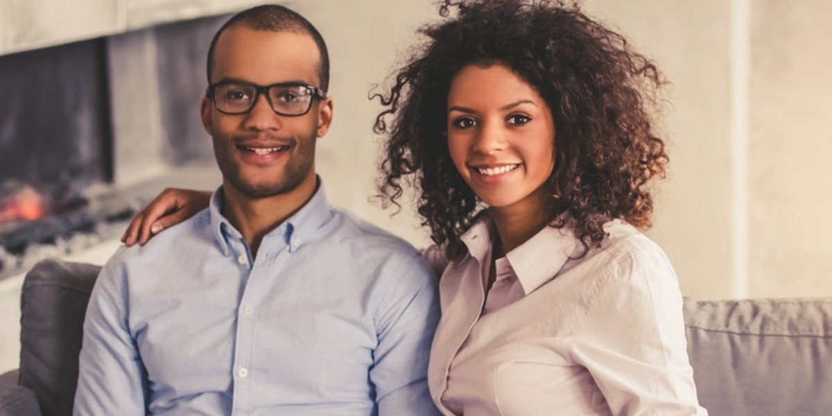 Financing Strategies for an investment property   couple smiling