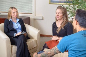 Patience Young Couple Talks with Businesswoman sell my Riverside house fast