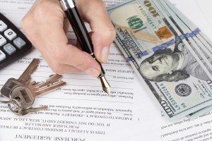 Responsibility Hand fills out an agreement sell my Riverside house fast
