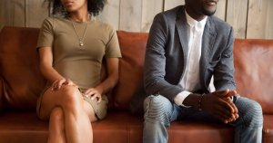 couple sitting on couch after quarrel, bad relationships concept