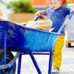 Prepare Your Inherited House For The Sale | kid and wheelbarrow