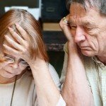 Dealing With Tenants Who Don't Pay Rent | stressed older couple