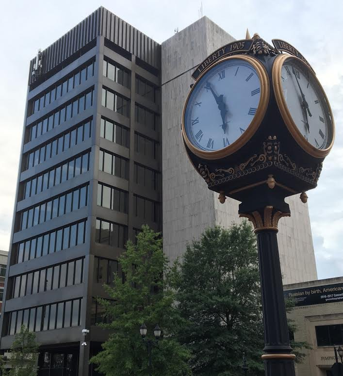 a clock in the center of Greenville, on the sell your house fast for cash in Greenville - SC page