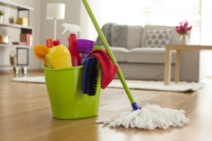 house with cleaning supplies