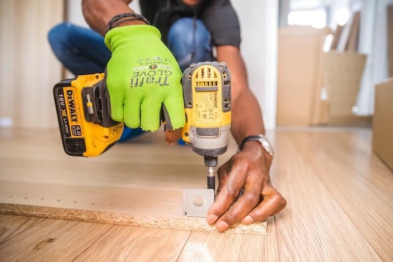 Handyman doing home repairs in rental property