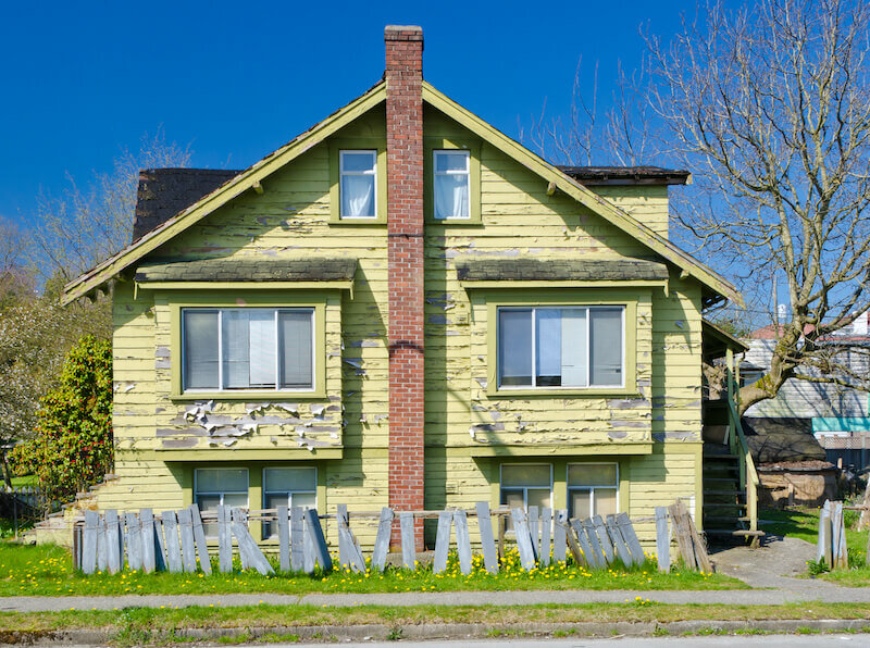 a run down house in Lincoln Nebraska for sale as-is