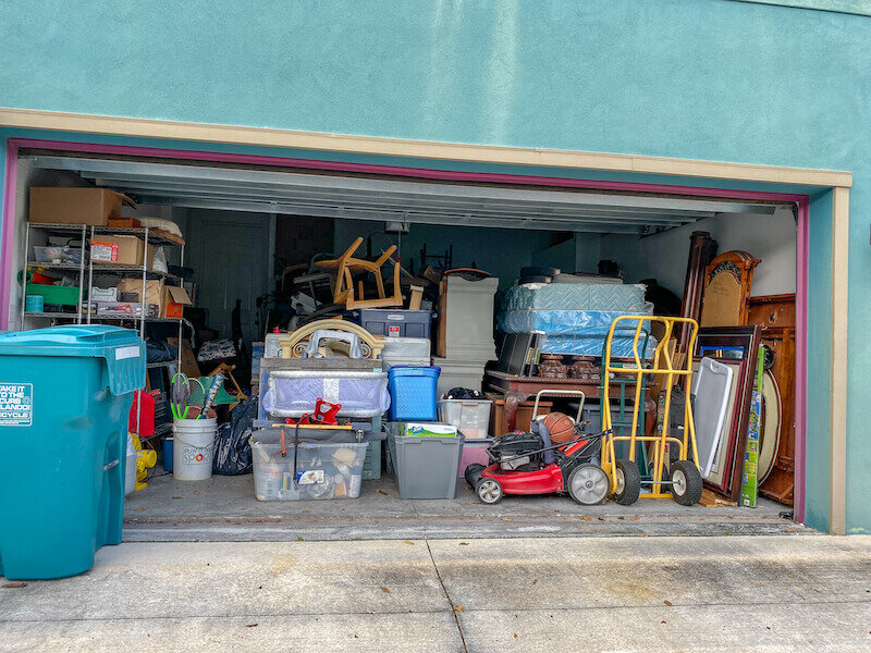 a hoarders garage filled with many unorganized stuff