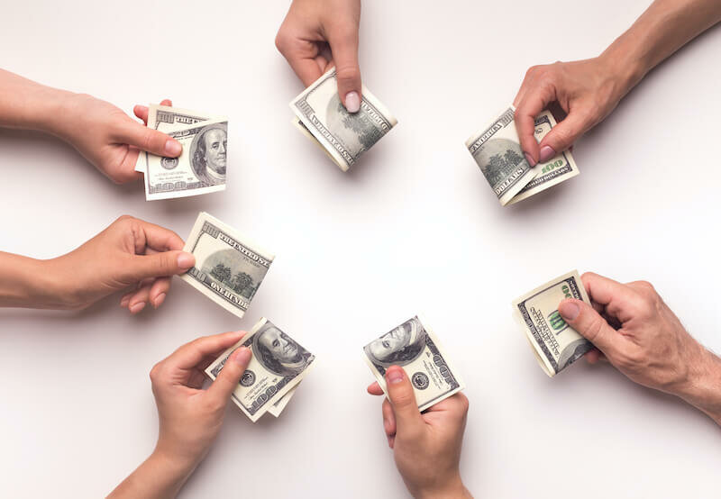 siblings hands with money on each one