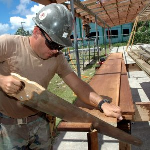Renovate for Profit Fort Myers Florida Man cuts wood for renovated house