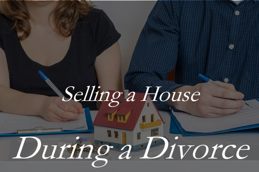 A man and woman signing divorce papers with a model of a house in front of them