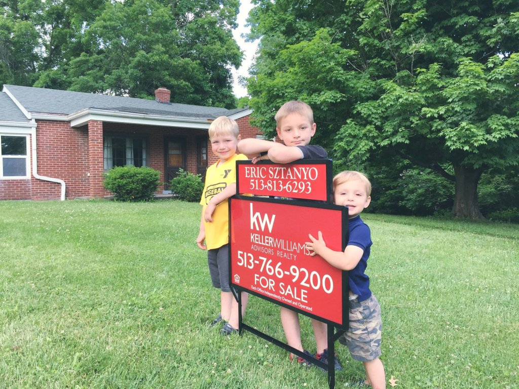 team sztanyo - cincinnati real estate agent - sons with listing yard sign