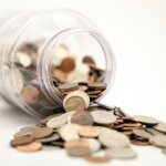 The Pre-Approval Process - coins saving up money for a house