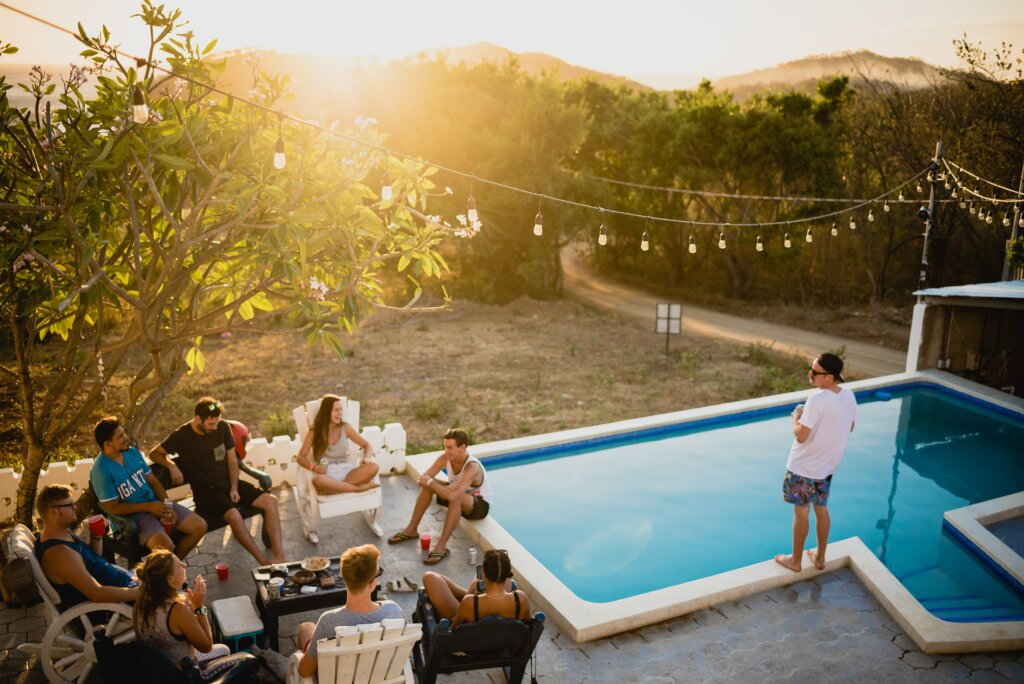 How To Gain Maximum Exposure When Selling Your House in Cincinnati or Northern Kentucky  - people sitting around a pool