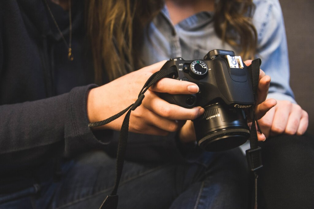 5 Ways To Get Great Listing Photos of Your Cincinnati or Northern Kentucky House - person holding camera