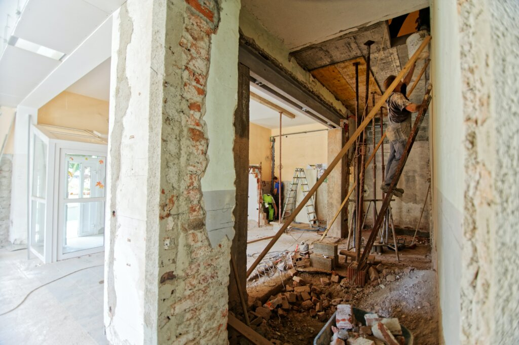 What You Should Know About Buying a New Construction Home in Cincinnati or Northern Kentucky - man building