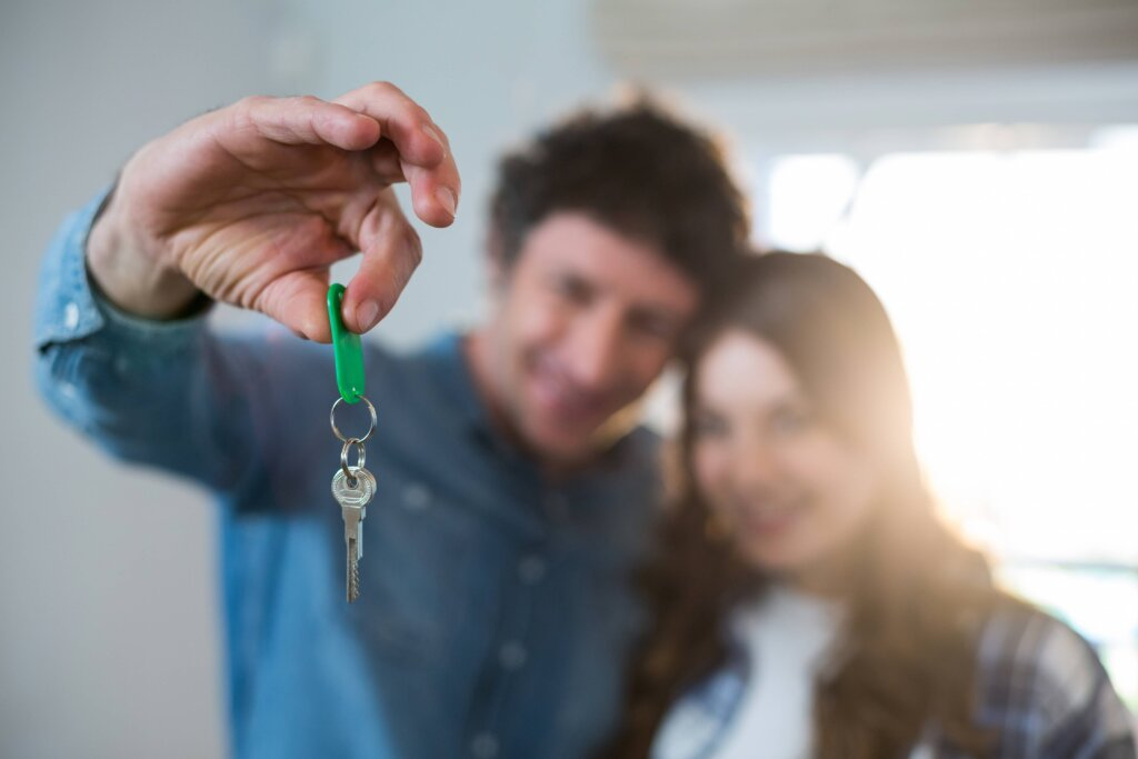 Selling vs. Renting Out a Home- Handing over keys