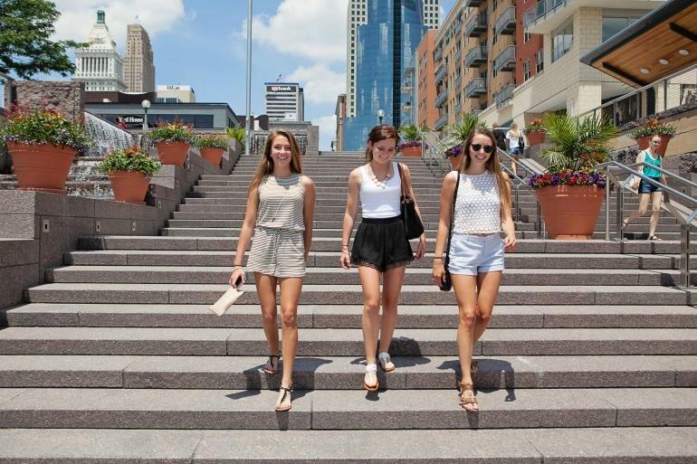 the banks cincinnati - sunshine girls on steps - great place for friends
