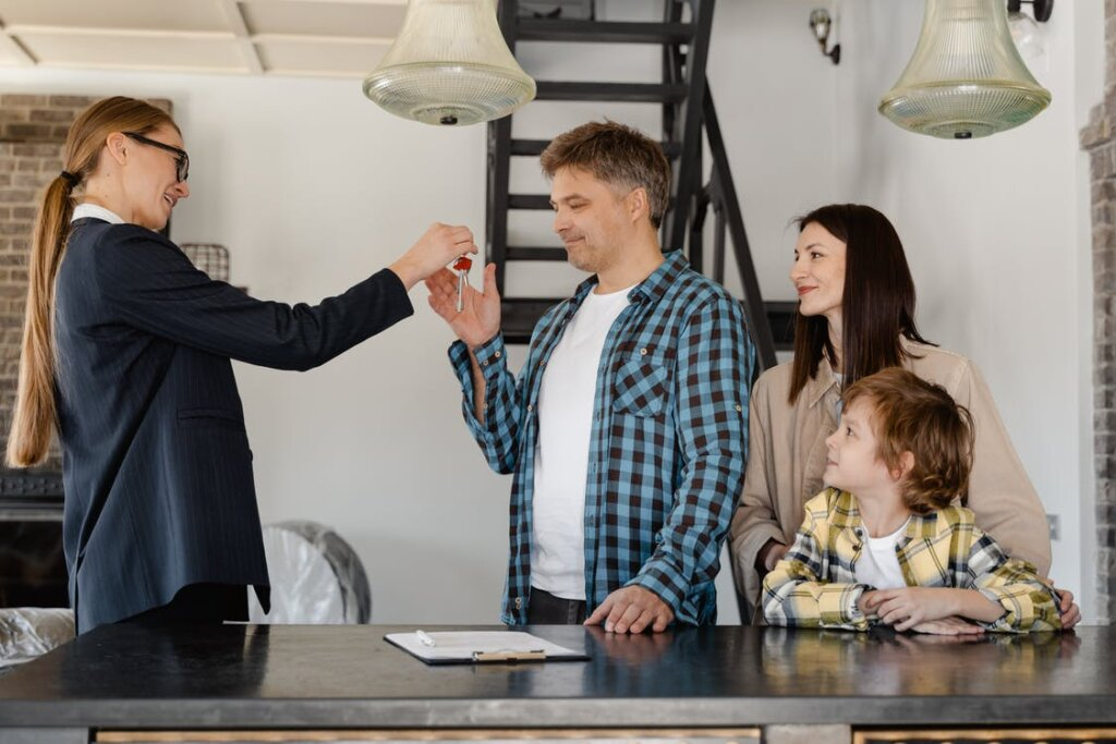 A real estate agent handing over keys to a new homeowner
