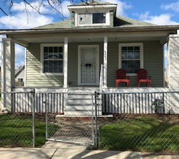 Fully fenced Green Vinyl House for sale in Detroit
