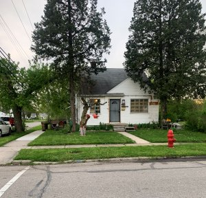 Shingle with white painted wall home for sale in Patton St. Detroit
