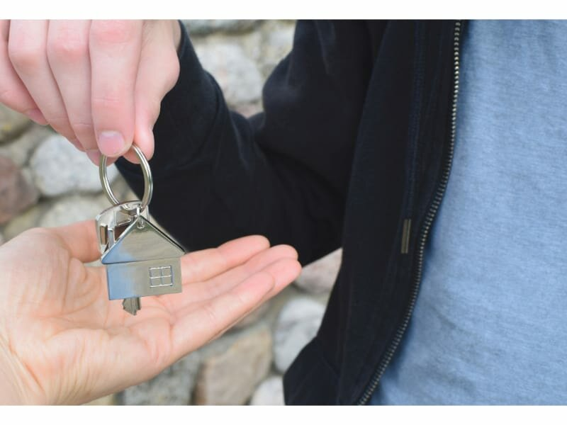 Man handing house keys