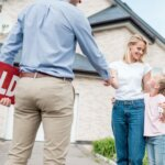 woman_with_daughter_buying_new_house_and_shaking_hand_of_male