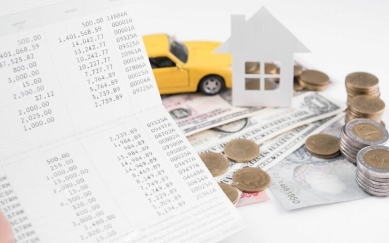 money, pile coin with account book and paper home, car