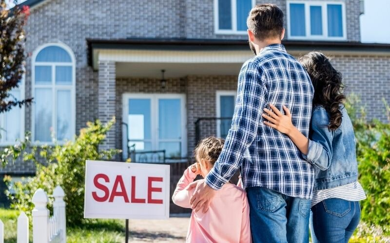 family looking at house on sale