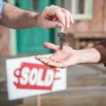 man buying new house and taking keys