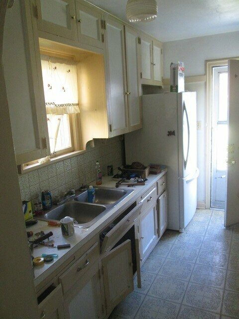 kitchen needing repairs and updating sold as is with no repairs in Kansas City Brookside