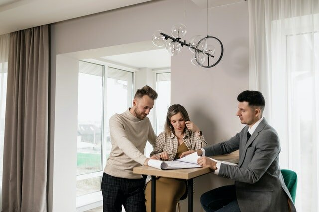 A couple with their real estate agent