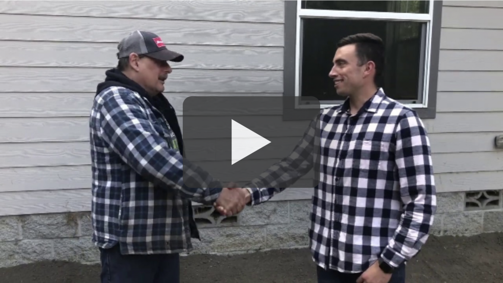 Owner of kind house buyers shaking hands with happy seller